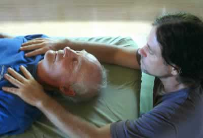 Mana hands on healing a participant in the Breath of Light training