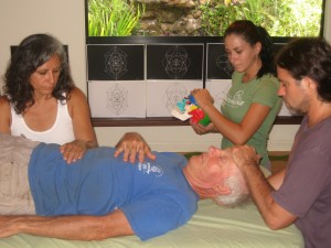 Mana with students doing hands on healing